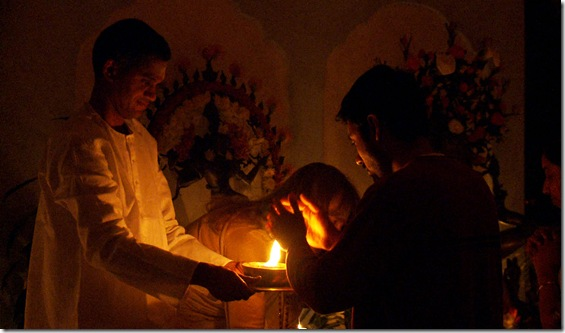 devotees taking camphor light at murtis