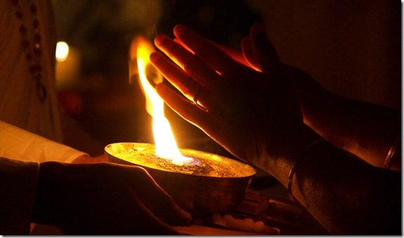 hands taking camphor flame