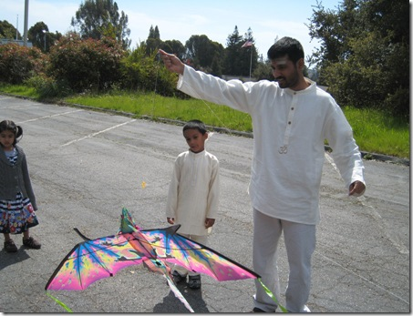 gnana p with kite and children